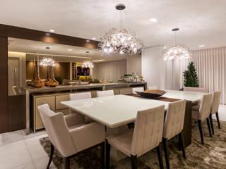 Apartamento luxo Salas de jantar modernas por Home projetos Moderno