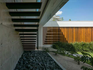 Residência Guaicá: Casas  por Padovani Arquitetos + Associados