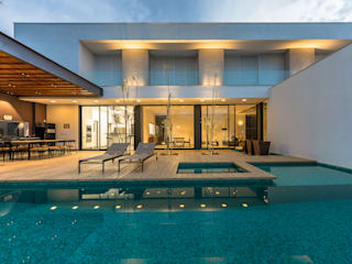 Residência Boa Vista: Casas  por Padovani Arquitetos + Associados