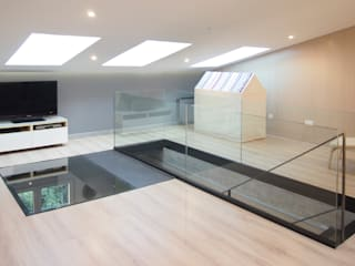 REFORMA DE UN DUPLEX: Salones de estilo  de Búho Arquitectos SLP