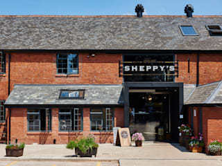 Sheppy's Cider de Barc Architects Rústico