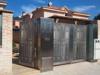 Espectaculares portones para tu hogar de Lamitec SA de CV Moderno