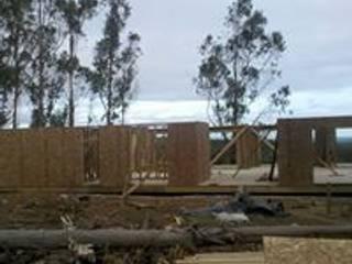 casa campo:  de estilo  por construcciones costa