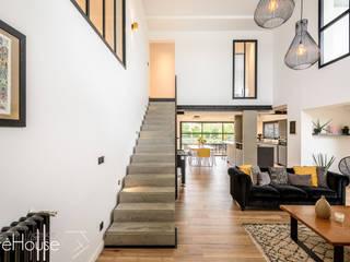 Rénovation d'une maison individuelle à Anglet Salon moderne par Agence CréHouse Moderne