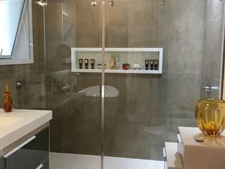 Banheiro senhora: Banheiros  por Juliana Matos Arquitetura e Interiores