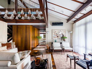 Casa AHR: Salas de estar  por Thiago Mondini Arquitetura,Eclético