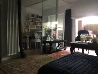 Salón separado con cristal: Salones de estilo  de Ana de Ramón FENG SHUI