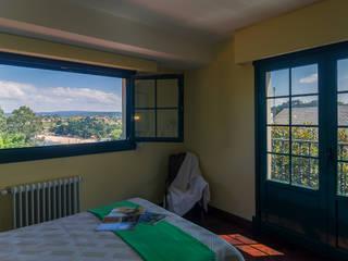 Rustikale Schlafzimmer von MORANDO INMOBILIARIA Rustikal