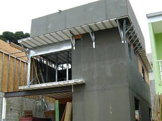CONSTRUÇÃO EM AÇO (LSF) - Na Vanguarda dos Sistemas Construtivos: Moradias  por Decorvisão | Sistemas de Remodelação e Construção LSF,Moderno