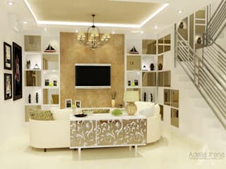 Wisata Bukit Mas, Surabaya: Ruang Keluarga oleh AIRE INTERIOR ,