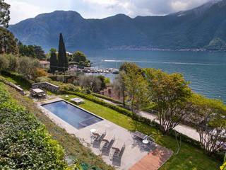 VL piscina_Progetto di una piscina e sistemazione delle aree esterne*: Giardino con piscina in stile  di Chantal Forzatti architetto