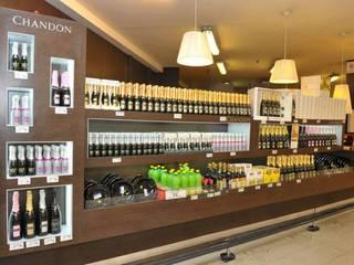 Reforma espacio Chandon - supermercado shopping:  de estilo  por En Tu Interior