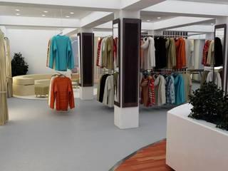 Exhibicion de ropa - Shoowroom: Oficinas y Tiendas de estilo  por En Tu Interior