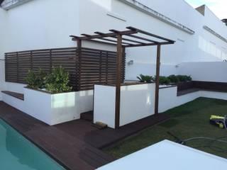 Jardim: Jardins  por Living Atmosphere