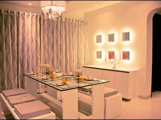Dining room by H interior Design,
