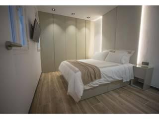 Dormitorios de estilo moderno de Empresa constructora en Madrid Moderno