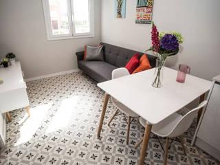 Grupo Inventia Salas de estilo moderno Concreto Beige
