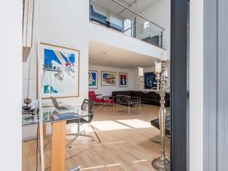 Salones modernos de Archipelontwerpers Moderno