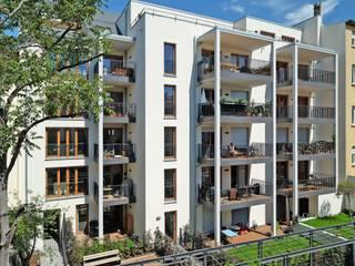 Neubau von zwei Mehrfamilienwohnhäusern mit Tiefgarage von Jüttemann Architekten