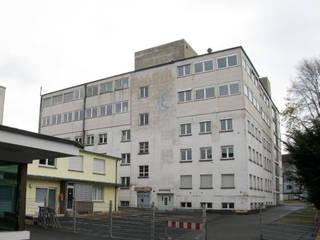 Umwandlung eines ehemaligen Fabrikgebäudes in ein Mehrfamilienwohnhaus von Jüttemann Architekten
