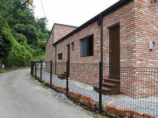 옥천 이백리 목조주택 (38py): 한다움건설의  목조 주택
