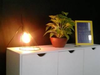 Projeto de interiores para o escritório de uma produtora de vídeo: Escritórios  por Laura Monte Palma Arquitetura e Interiores