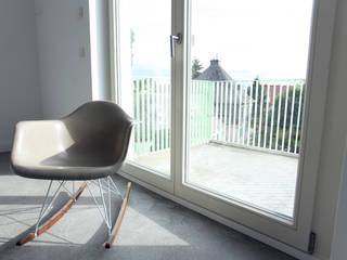Salas de estilo  por Neugebauer Architekten BDA