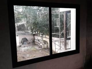 Casa Yerba Buena - RN:  de estilo industrial por Abertuc,Industrial