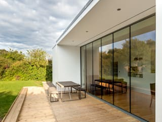 Sheltered Deck Overlooking Rear Garden :  Detached home by Capital A Architecture