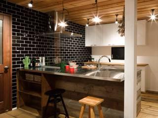 Cucina in stile industriale di dwarf Industrial