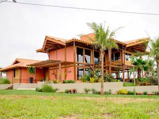 Residência Terras da Barra I: Casas  por VERRONI arquitetos associados,Rústico