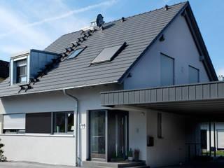 Neubau Wohnhäuser Niedernberg:  Einfamilienhaus von Resonator Coop Architektur + Design,