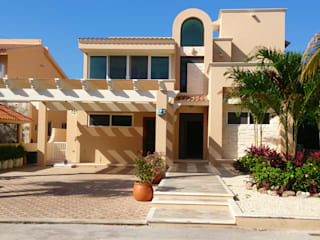 Nhà gia đình by DHI Arquitectos y Constructores de la Riviera Maya