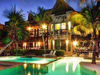 Houses by DHI Arquitectos y Constructores de la Riviera Maya, Tropical