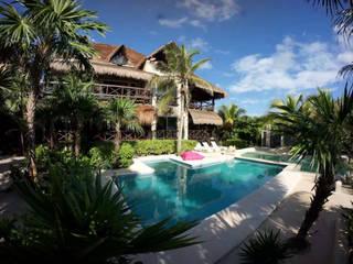 Houses by DHI Arquitectos y Constructores de la Riviera Maya, Rustic