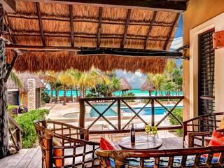 Living room by DHI Arquitectos y Constructores de la Riviera Maya, Tropical