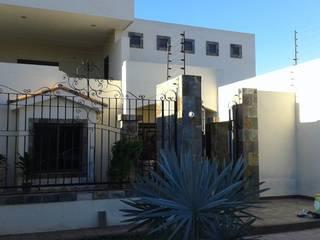 CASA38: Casas de campo de estilo  por ARQUITECTURA CONSTRUCCION