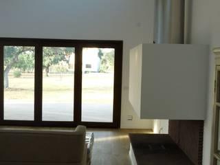 CASA MODELO CAVA EN CUIDAD REAL: Salones de estilo  de MODULAR HOME