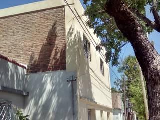 Casa Familiar. Calle Corrientes. Rosario. Casas rústicas de Arq. Gustavo Piazza & Asociados Rústico