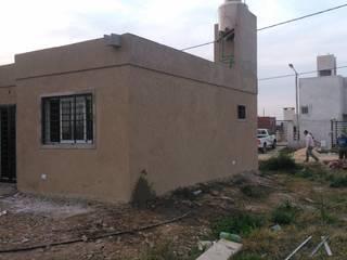 Casa Familiar. Manzana 89. Tierra de Sueños 3. Roldan. Casas minimalistas de Arq. Gustavo Piazza & Asociados Minimalista