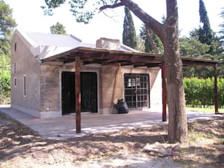 Rustic style houses by Arq. Gustavo Piazza & Asociados Rustic
