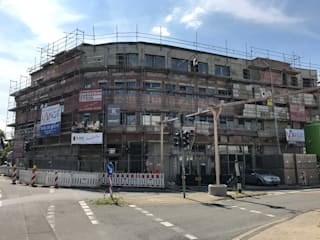Neubau Wohn- und Geschäftshaus:  Mehrfamilienhaus von ludebühl | architekten