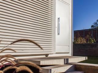 Casa 12.20: Casas  por Alex Nogueira,Moderno