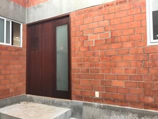 Casas unifamiliares de estilo  por Nodo Arquitectos