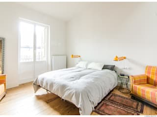 Reforma de Atico en Pamplona: Dormitorios de estilo  de TALLER VERTICAL Arquitectura + Interiorismo