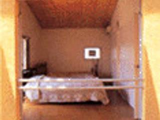 秦野Alley モダンスタイルの寝室 の 一級建築士事務所 サイコ モダン