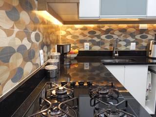 Cozinha: Armários e bancadas de cozinha  por Seleto Studio Design de Interiores,Moderno