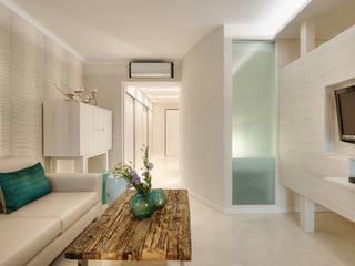 Renovação Apartamento Férias Salgados: Salas de estar  por CORE Architects,Moderno