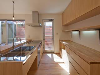 シカクの家: 株式会社田渕建築設計事務所が手掛けたキッチン収納です。,