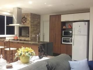 Área social de apartamento de férias : Cozinhas  por daniela oliveira arquitetura,Tropical